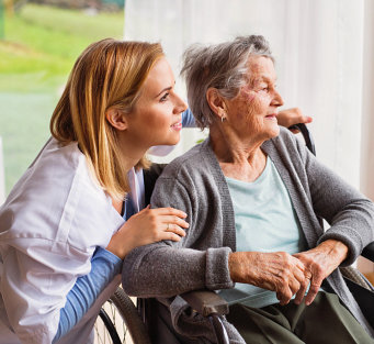 caregiver and elderly woman in wheelchair