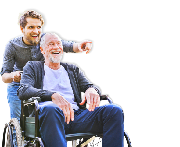 caregiver and elderly in wheelchair laughing